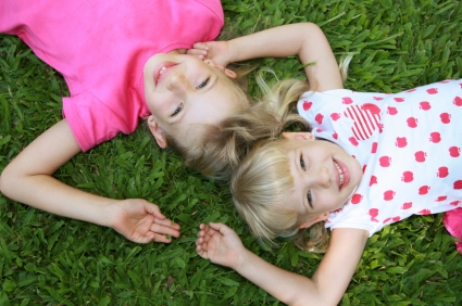 Laying in grass at daycare preschool